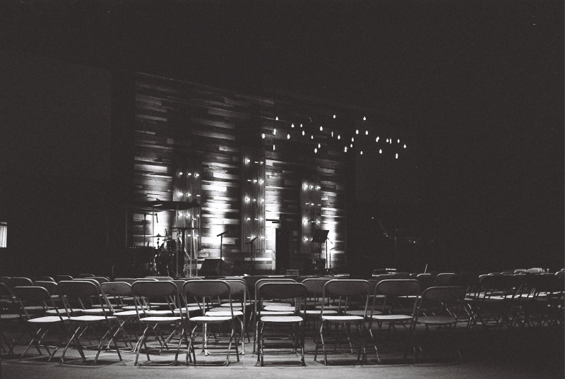 grayscale-photography-of-chairs-in-an-auditorium-2305084 small