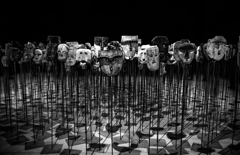 greyscale-photo-of-masks-on-a-stick-669319